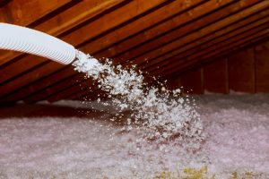 Spraying Blown Fiberglass Insulation for roof technician spraying foam insulation using plural component gun
